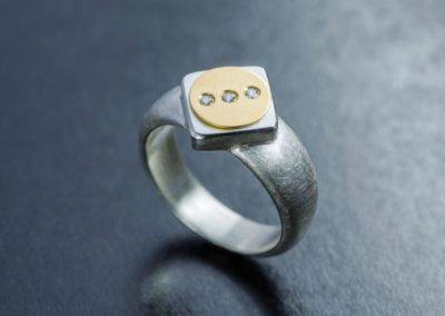 Ring: Silber, Gelbgold und Diamanten